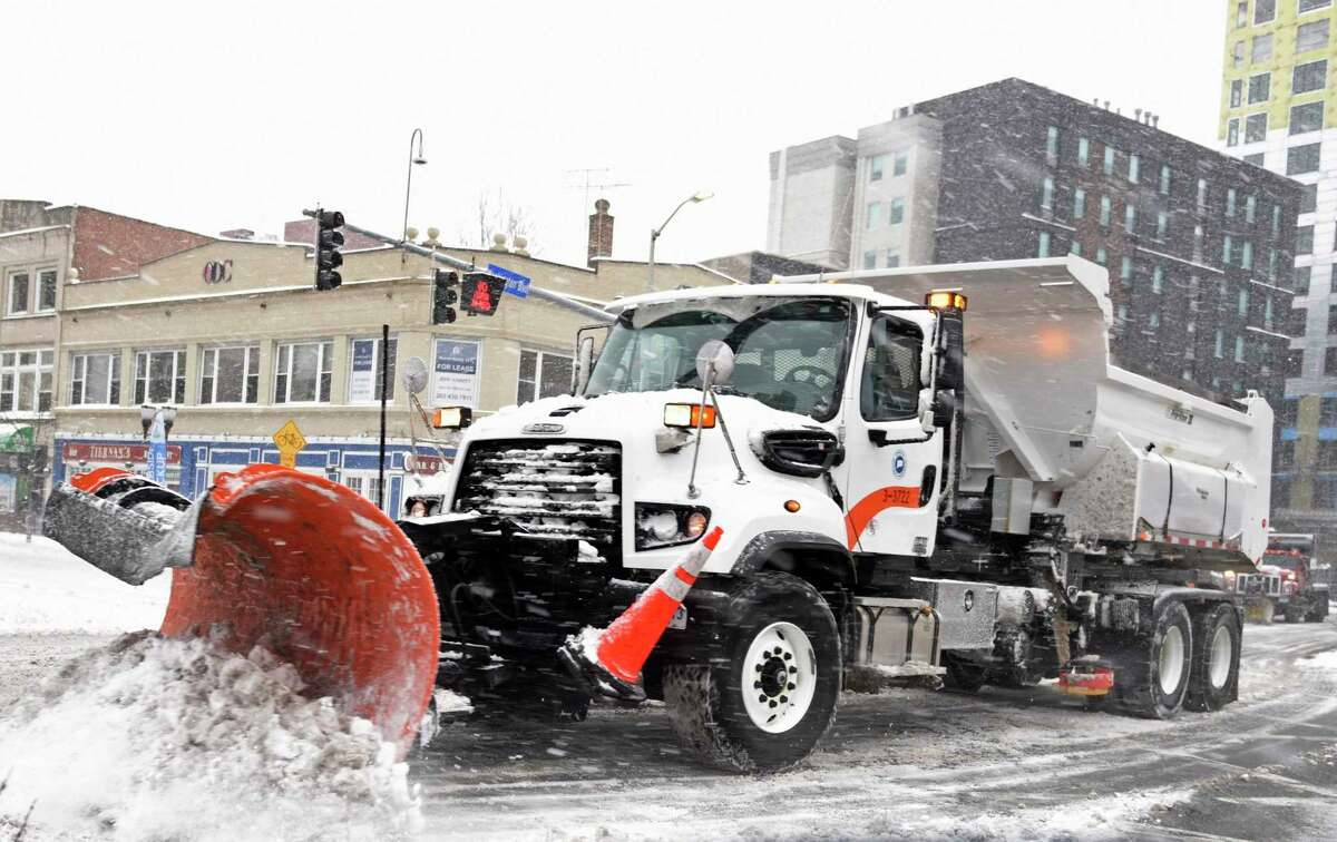 A plow clears snow from Washington Boulevard in Stamford, Conn. Monday, Feb. 1, 2021. The area received consistent light snow starting Sunday evening and continuing throughout the day Monday.