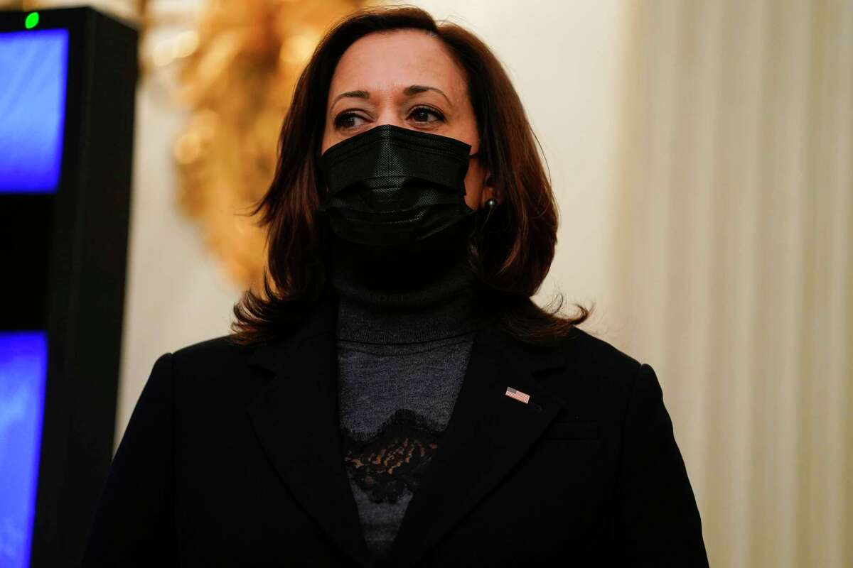 Vice President Kamala Harris listens as President Joe Biden delivers remarks on the economy in the State Dining Room of the White House, Friday, Jan. 22, 2021, in Washington.