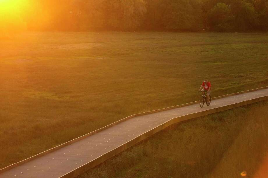 A bicyclist makes his way close to sunset one evening in 2019 along the Salado Creek section of the Howard W. Peak Greenway Trail System. Photo: William Luther /Staff / ©2019 San Antonio Express-News