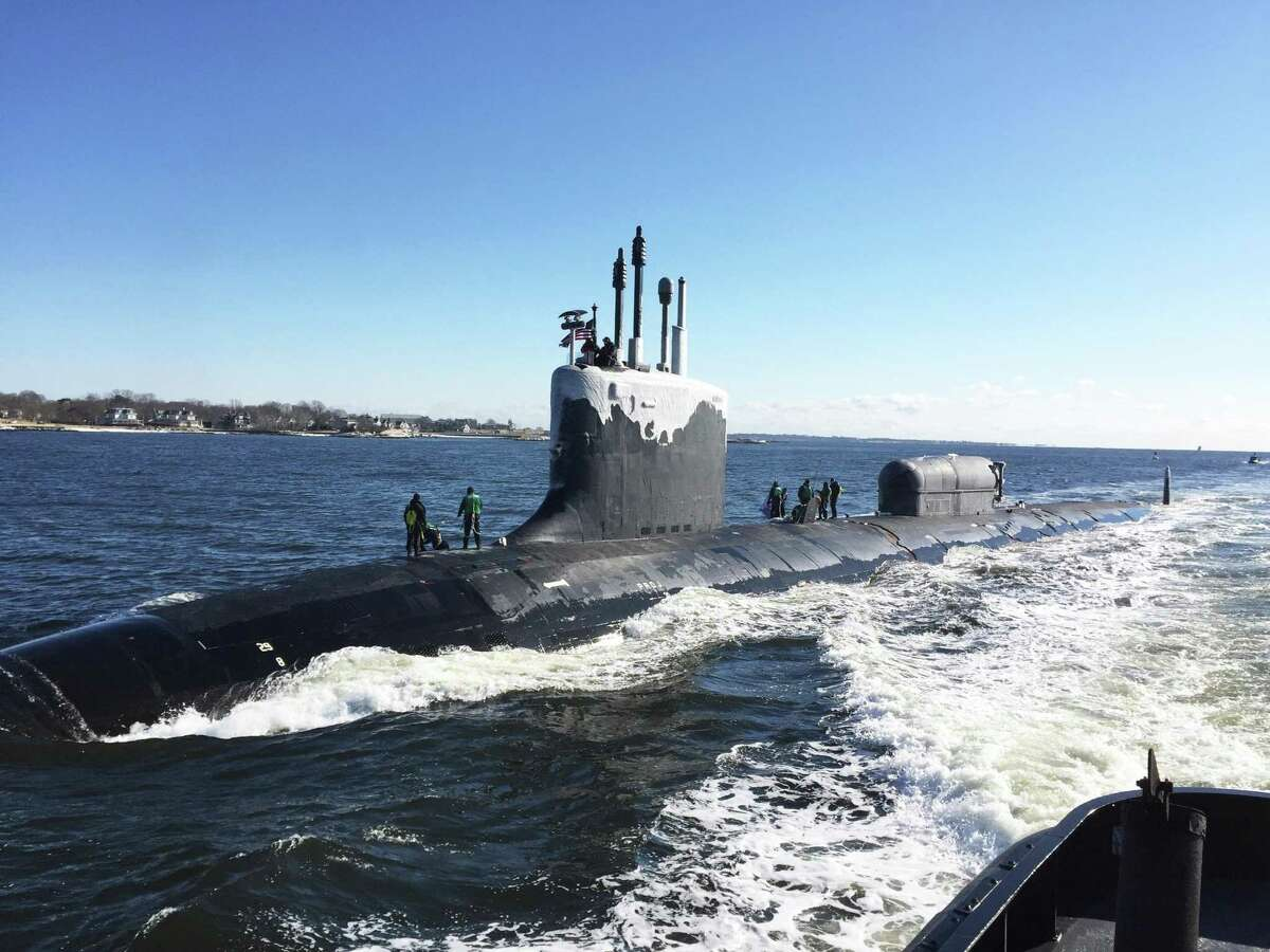 The Virginia-class fast-attack submarine USS North Dakota enters the Thames River in January 2019 en route to the Naval Submarine Base New London in Groton, Conn., where the submarine was built at Electric Boat owned by General Dynamics. (U.S. Navy photo by Cmdr. Jason M. Geddes)