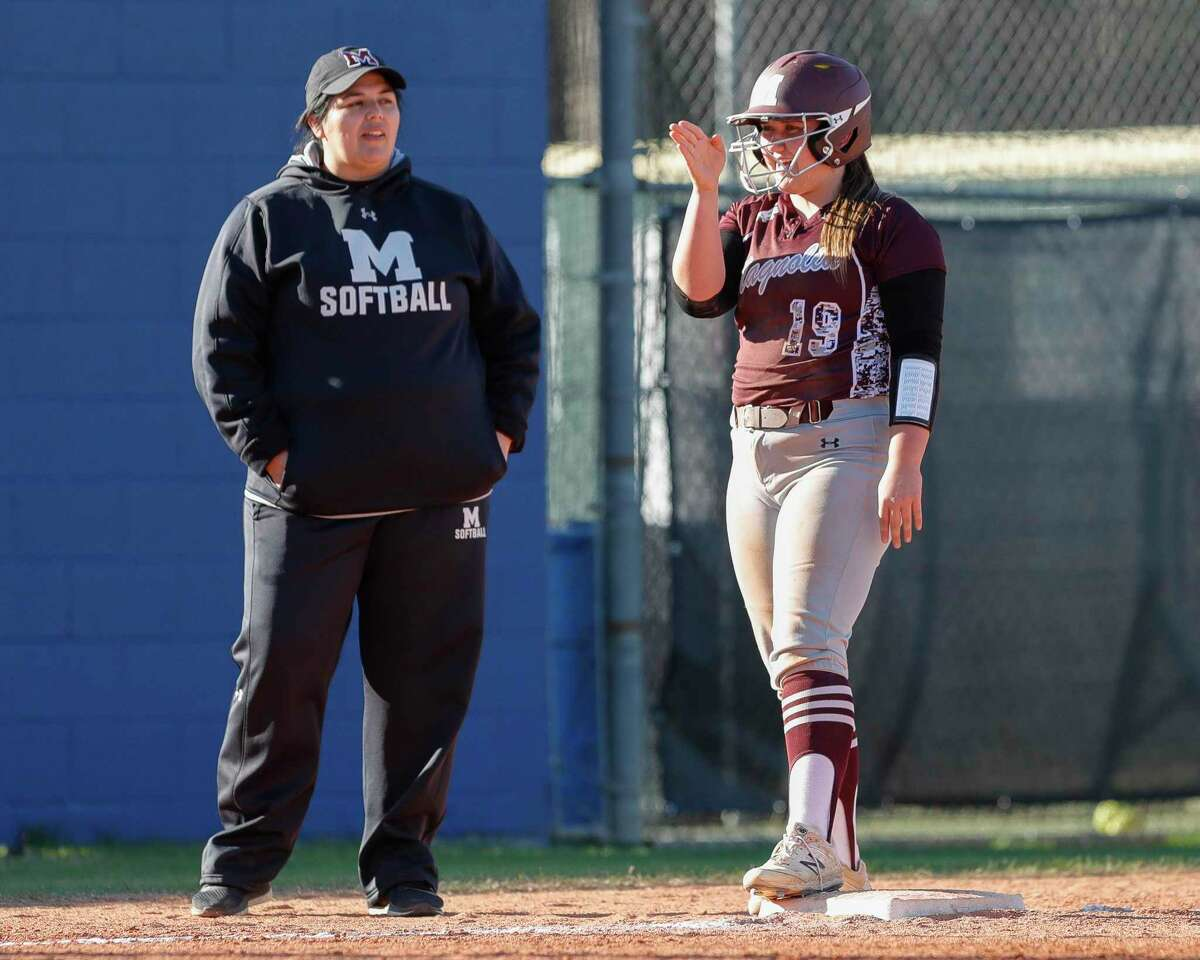 Magnolia's Caitlyn Stevens gestures for Gabrielle Huetter to hit the ball straight during the fourth inning of a non-district high school softball game at Oak Ridge High School, Thursday, Feb. 27, 2020, in Oak Ridge.
