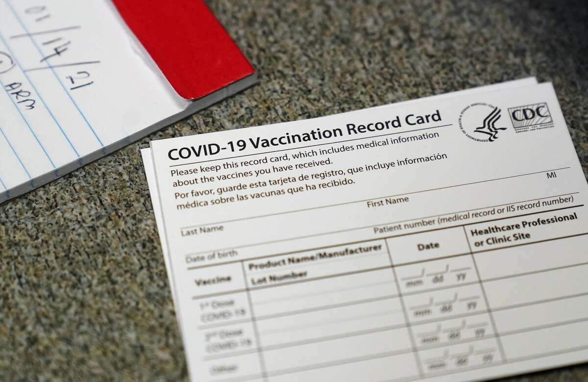 FILE - A COVID-19 vaccination record card is shown at Seton Medical Center during the coronavirus pandemic in Daly City, Calif.