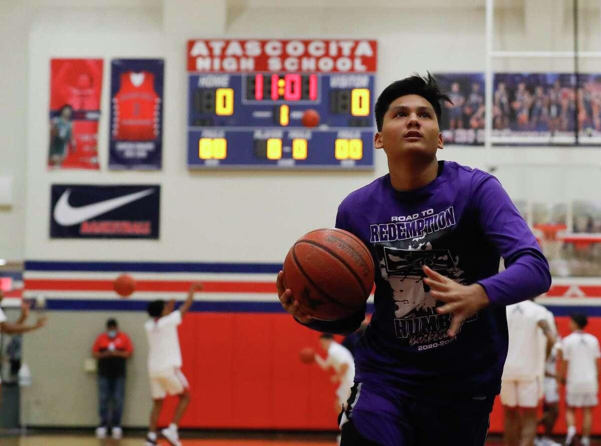 Humble guard Landyn Jumawan (20) warms up before a District 21-6A high school basketball game at Atascocita High School, Saturday, Jan. 16, 2021, in Atascocita.