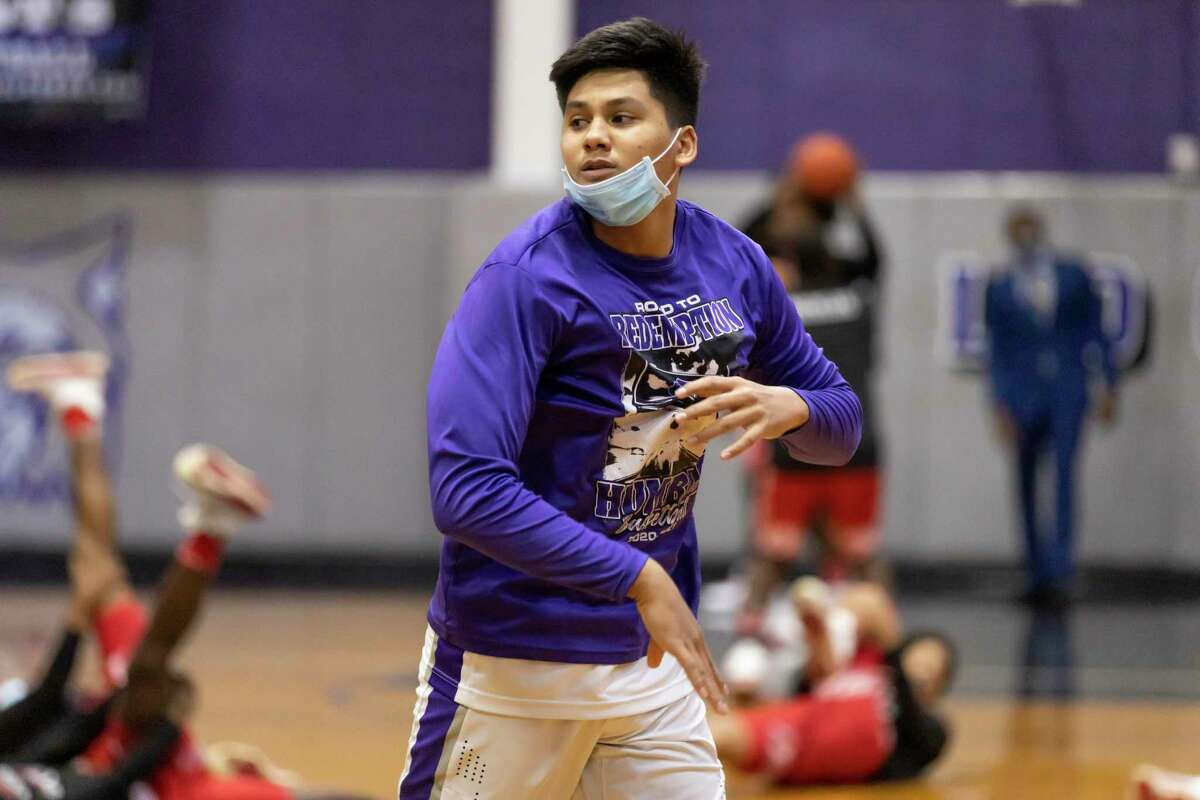 Humble forward Landyn Jumawan (20) looks out to his teammates during warm up before the start of a District 21-6A basketball game at Humble High School, Wednesday, Jan. 20, 2021, in Humble.