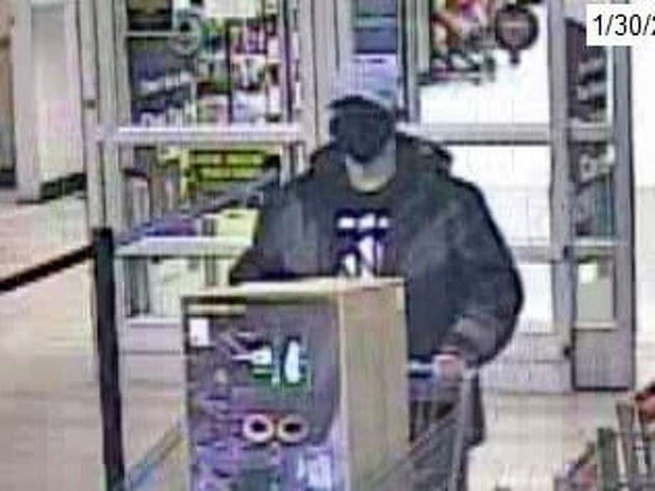 Pictured is the second individual believed to be responsible for a theft taking place at the Big Rapids Walmart Saturday evening. The man is alleged to have pushed a cart out of the store with $400 in merchandise. (Courtesy photo)