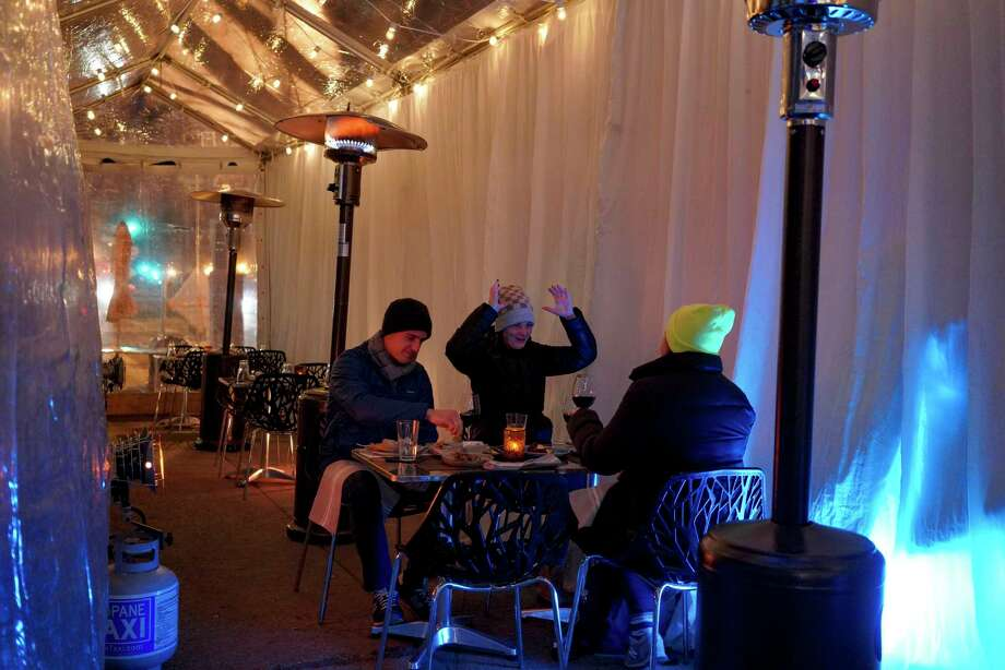 Ryan Rabac, Clara Goldfield and Sarah Baline dine in a tent outside Sababa on January 29, 2021, in Washington, D.C.. Photo: Washington Post Photo By Bonnie Jo Mount. / The Washington Post