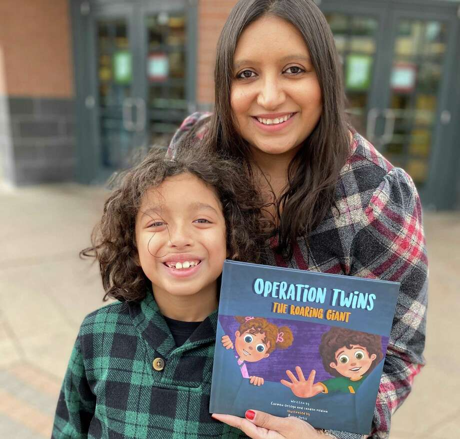 """Conroe residents Carmen Ortega and her son, Landon Medina, 8, worked together to publish a children's book """"Operation Twins The Roaring Giant."""" It is available through Barnes and Noble. Photo: Courtesy Photo"""