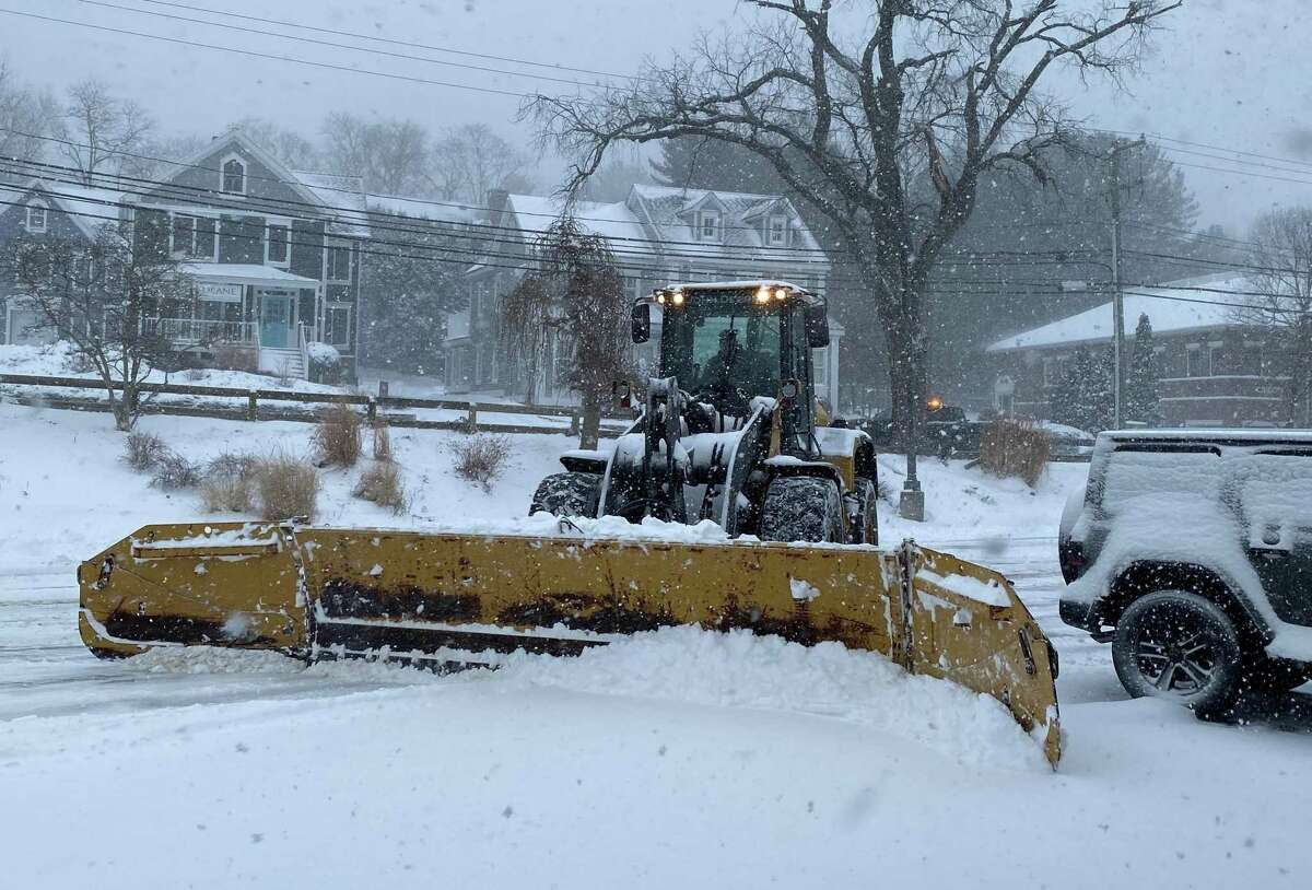 New Canaan Department of Public Works plows the Train Station parking lot on the morning of Monday, Feb. 1, 2021.