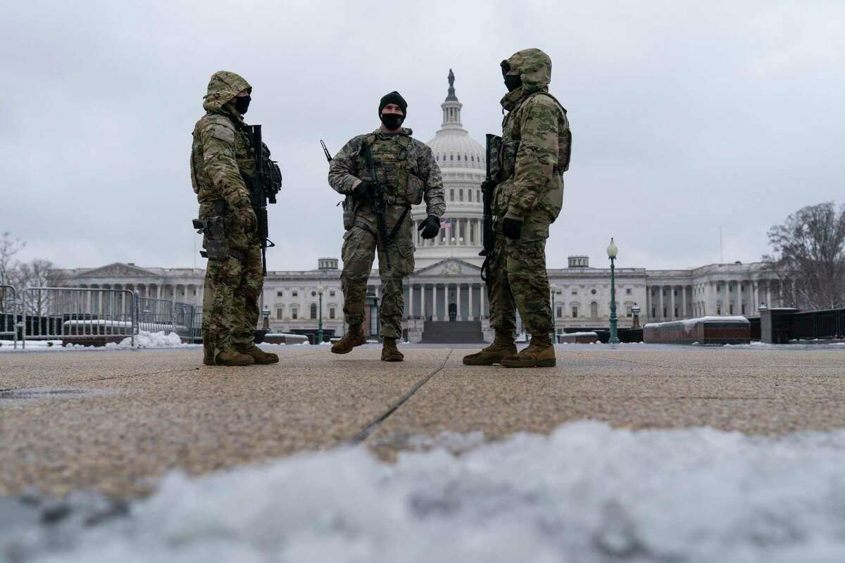 National Guard soldiers stand their post on the East Front of the U.S. Capitol on Monday.