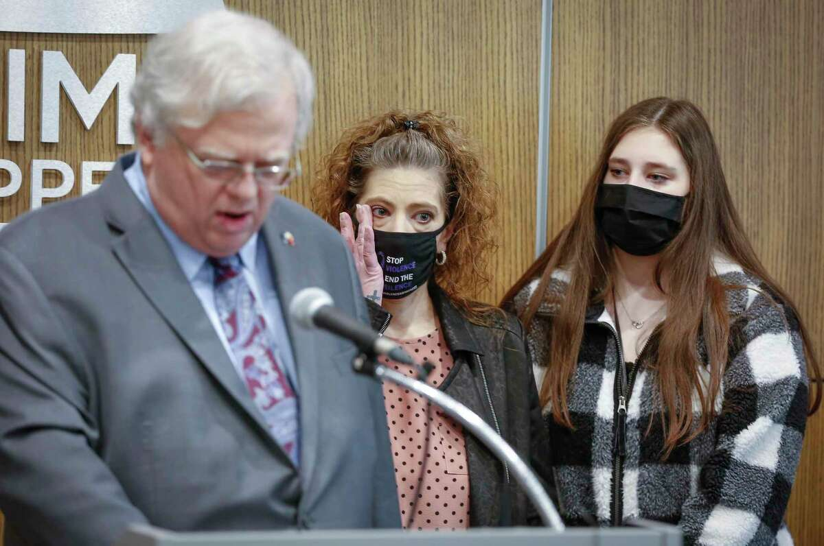 """Senator Paul Bettencourt (left-right) addresses the media as Melanie Infinger wipes away a tear after talking about her daughter Caitlynne, with her other daughter, Madison Marchand during a press conference to announce """"Caitlynne's"""" bill filing on Personal Recognizance Bonds Monday, Feb. 1, 2021, in Houston."""