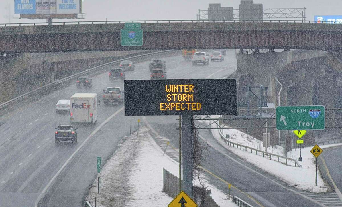 Vehicles are driven north on Interstate 787 as snow falls on Monday, Feb. 1, 2021, in Albany, N.Y. The state put a 45 mph speed limit on I-87 from Albany to NYC. (Paul Buckowski/Times Union)