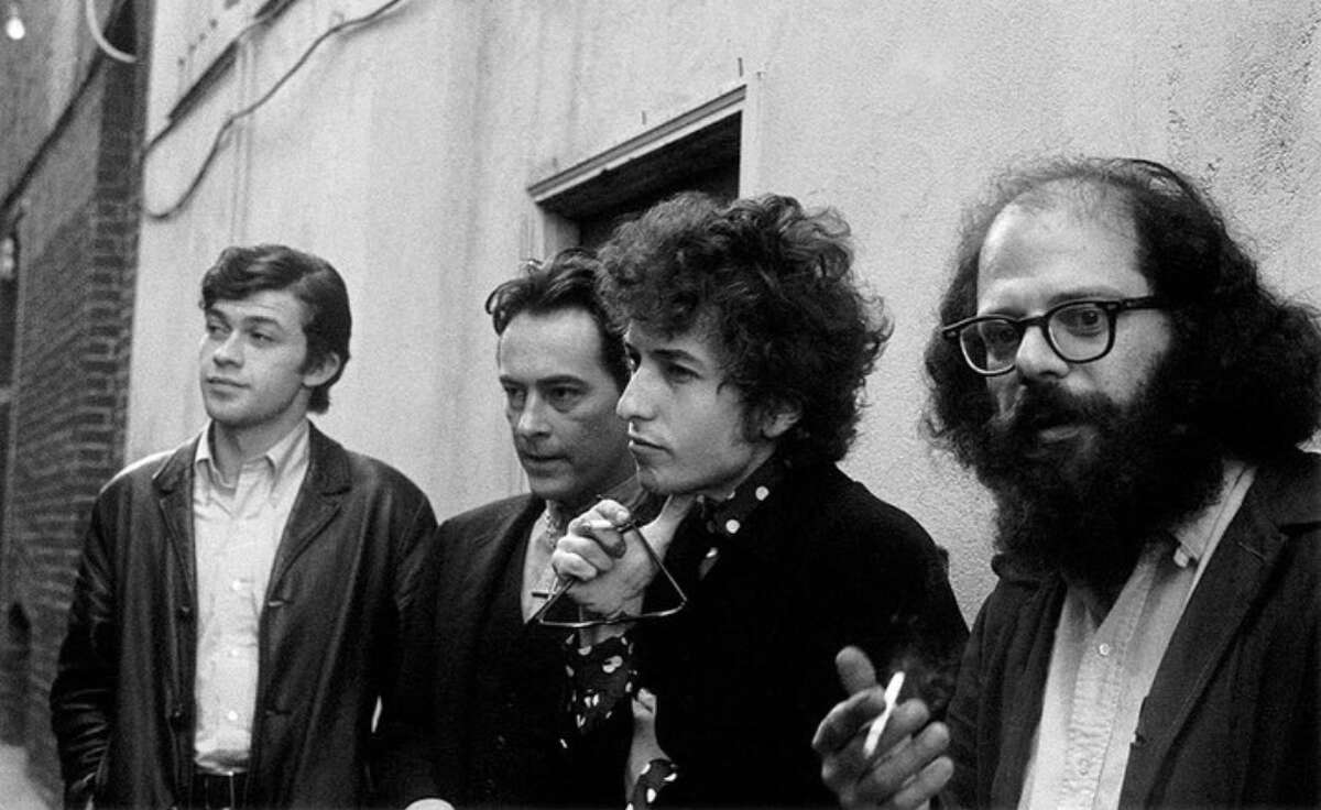 Robbie Robertson, Michael McClure, Bob Dylan and Allen Ginsberg outside Vesuvio in 1972