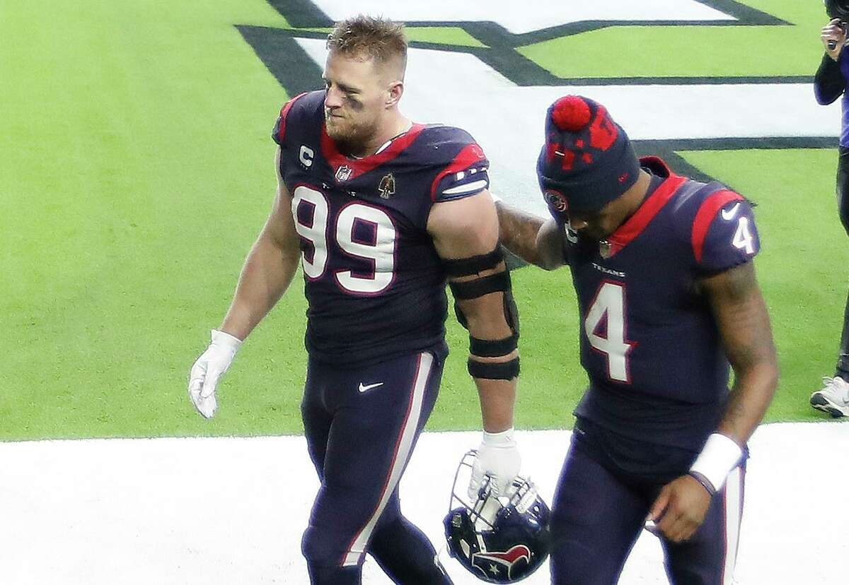 J.J. Watt, walking off the field with Deshaun Watson after the final game, has a big salary cap number for next season.