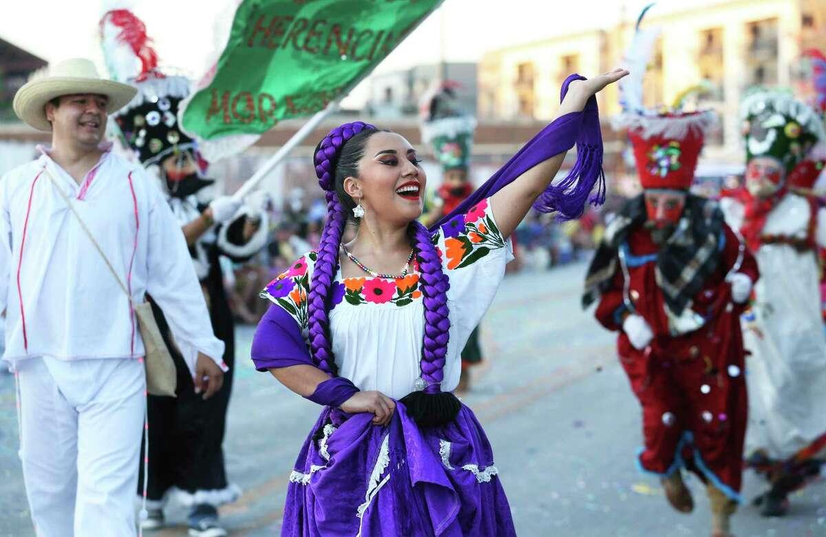 Grupo Folklorico De Bendiciones dancers enjoy the crowd during the Fiesta Flambeau Parade on April 27, 2019.