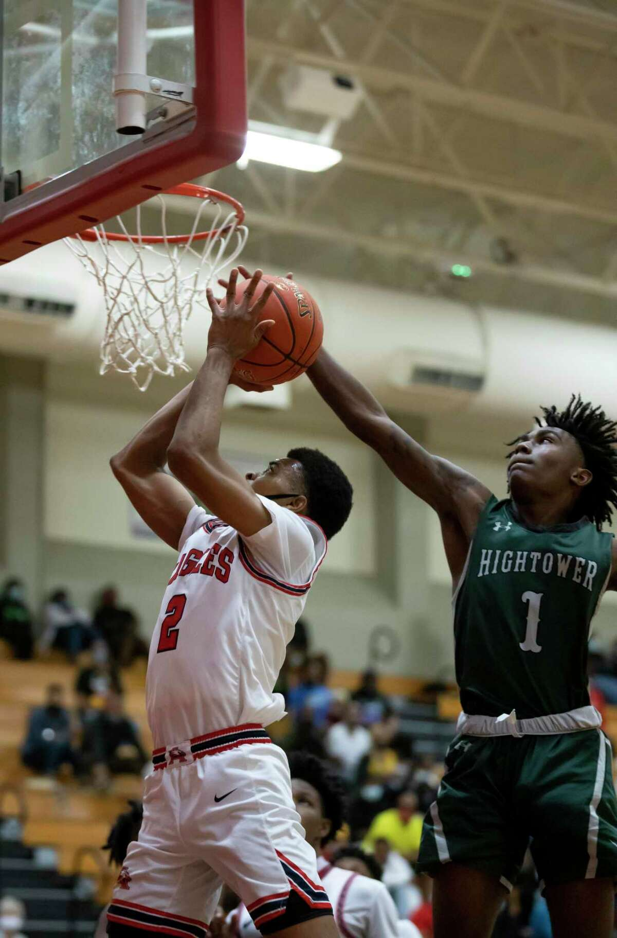 Fort Bend point guard Zackary Guidry (1) pressures Atascocita Angel Johnson (2) from scoring during the fourth quarter of a non-district basketball game at Atascocita High School, Wednesday, Nov. 25, 2020, in Atascocita.