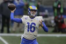 In this Jan. 9, 2021, file photo, Los Angeles Rams quarterback Jared Goff throws a pass against the Seattle Seahawks during the first half of an NFL wild-card playoff football game in Seattle.The Detroit Lions are trading quarterback Matthew Stafford to the Rams in exchange for Goff, two future first-round picks and a third-round pick.