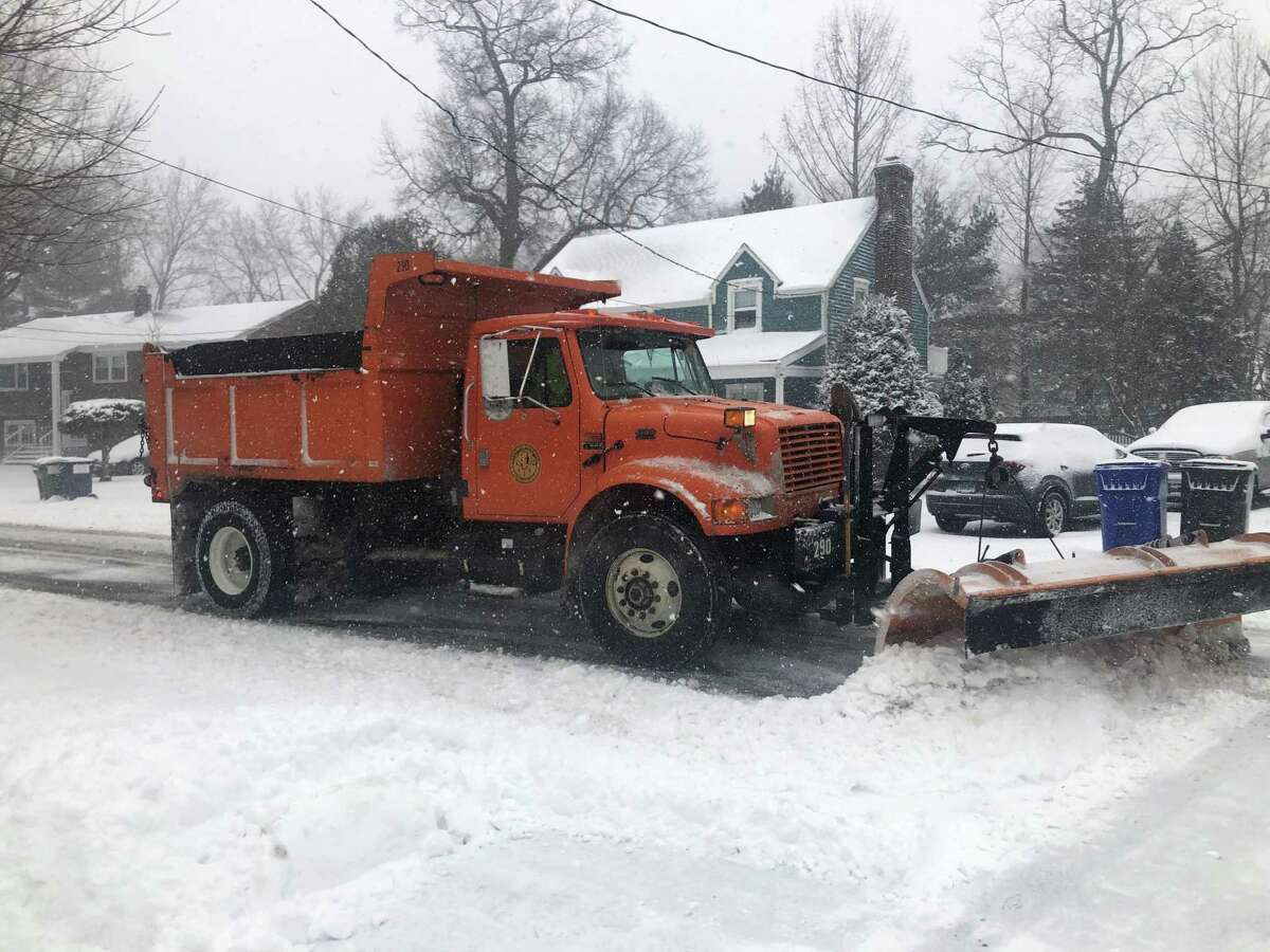 A plow truck clears snow on Lynnbrook Road in Fairfield Monday, Feb. 1, 2021.