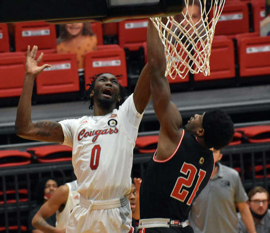 SIUE junior forward Sidney Wilson goes up for a contested shot in the second half of Monday's game against Austin Peay State University inside First Community Arena in Edwardsville.