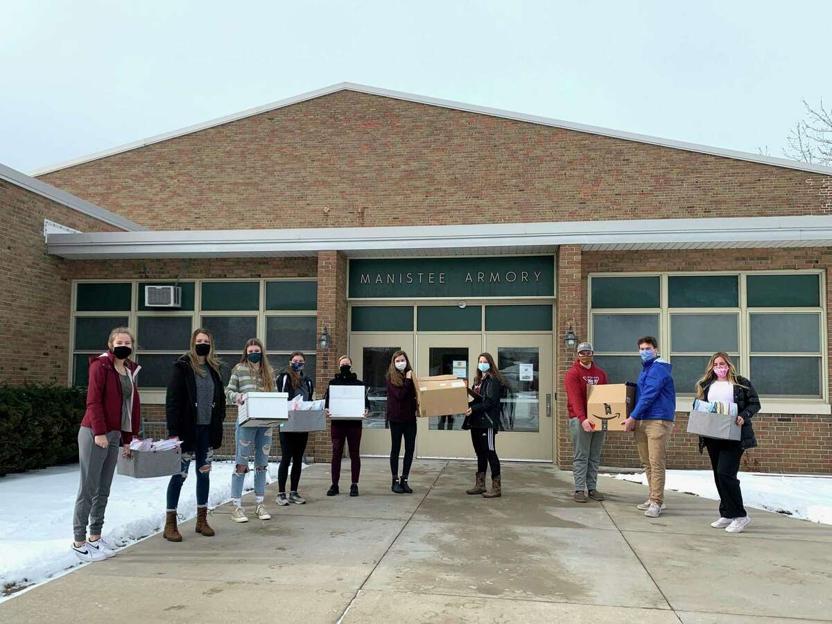 """Students from the Manistee County Child Advocacy Center's Youth Ambassadors program assembled 100 """"coping kits"""" during a winter meeting on Saturday.Pictured (fromleft to right)areKaylin Sam, Sophie Wisniski, Mairin McCarthy, Courtney Haag, Taylor Merrill, Libby McCarthy, Alexia Rineer, Jake Petrosky, Benjamin Falk and Muriel McColl. Not picturedis Alyssa Jackoviak. (Courtesy photo)"""