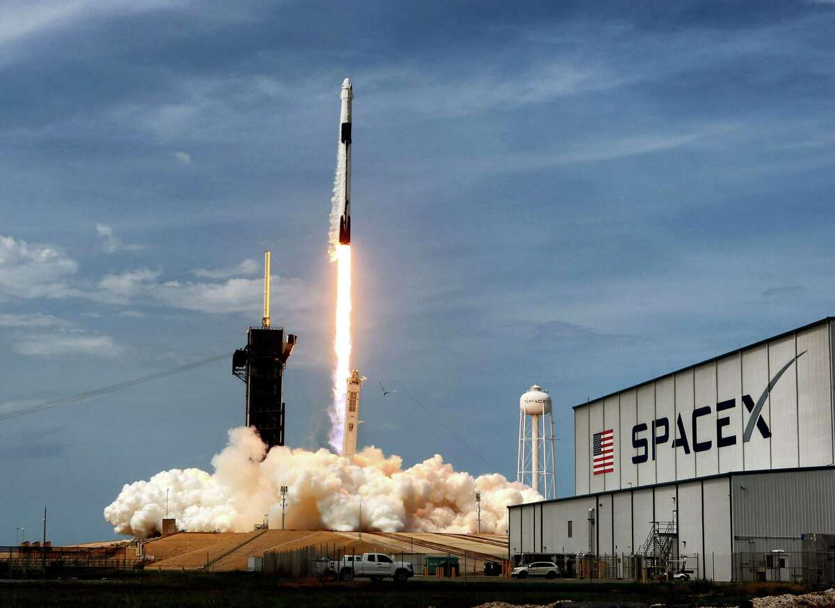 The SpaceX Falcon 9 rocket carrying astronauts Doug Hurley and Bob Behnken in the Crew Dragon capsule lifts off from Kennedy Space Center, Fla., Saturday, May 30, 2020. (Joe Burbank/Orlando Sentinel/TNS)