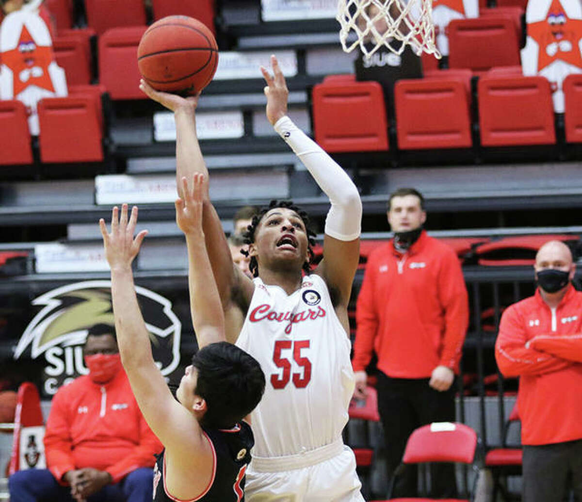 SIUE's Lamar Wright (55) scores over Austin Peay's Carlos Paez during the first half Monday afternoon at First Community Arena in Edwardsville.