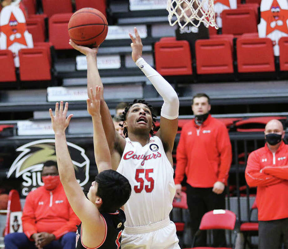 SIUE's Lamar Wright (55) scores over Austin Peay's Carlos Paez during the first half Monday afternoon at First Community Arena in Edwardsville. Photo: Greg Shashack / The Telegraph
