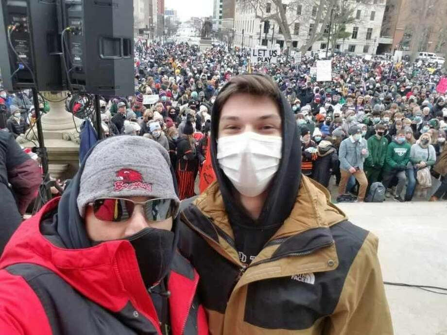 """Beaverton senior Cam Mishler (right) and Beaverton Rural Schools Superintendent Joe Passalacqua pose outside the state capitol building in Lansing during Saturday's """"Let Them Play"""" rally. Both Mishler and Passalacqua spoke during the rally. Photo: Photo Provided"""