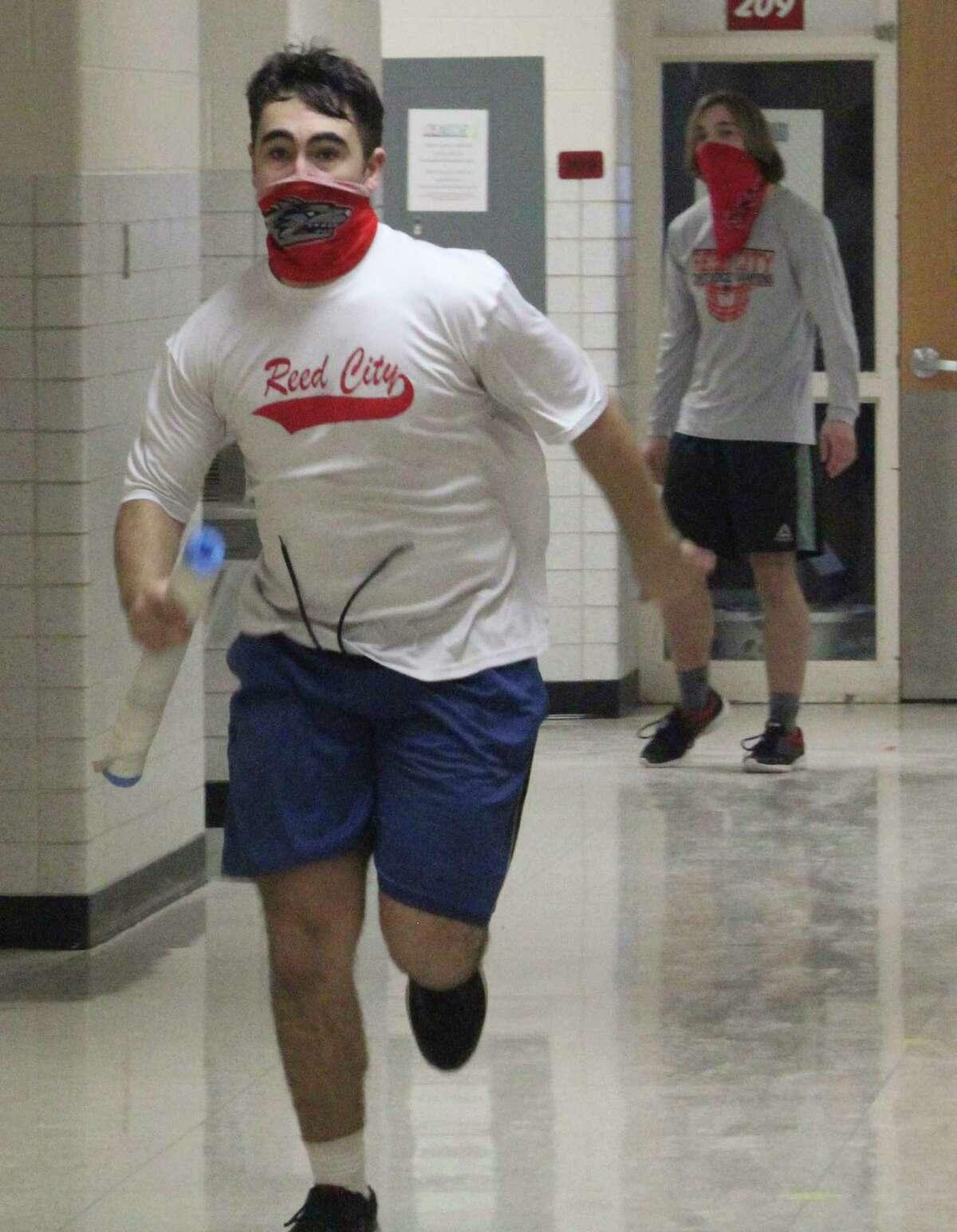 Reed City David Wayne runs through the hallway during wrestling practice last week. (Pioneer photo/John Raffel)