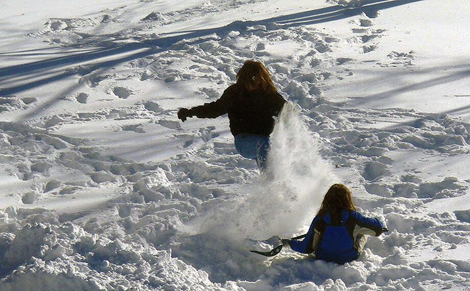 Although 12 inches of snow made it difficult for travel across west-central Illinois in February 2011, it provided fun for children in Jacksonville. Photo: Angela A. Bauer | Journal-Courier
