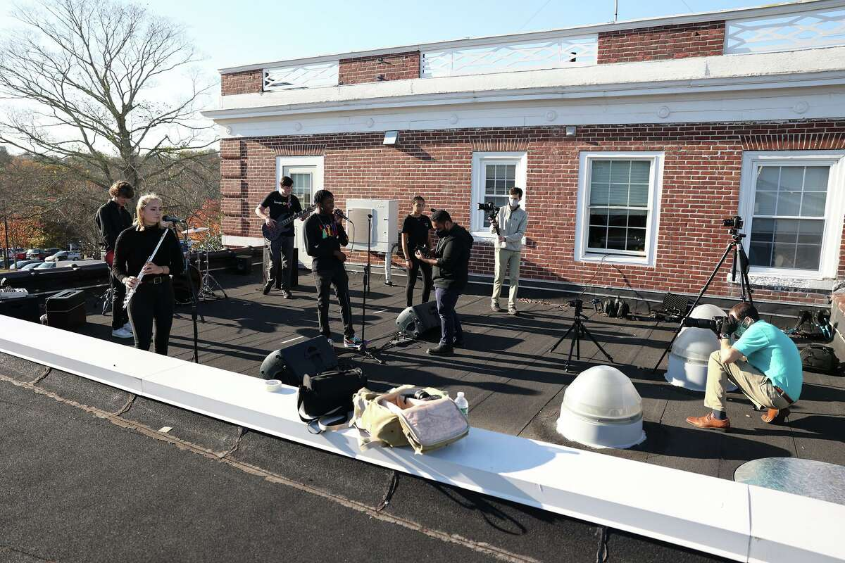 """A music video titled: """"Times Like These,"""" and featuring the St. Luke's School's in New Canaan Blues Band members, and was recently filmed on the school's rooftop, premiered at the school's 19th State of the School address on Thursday, November 19, 2020, and seems destined to go down in history as one of the coolest things a school has ever done. (From left) is: the St. Luke's School's Blues Band, A/V Specialist Bryan DeVissiere, a Senior student at the school, Brian Douglas, Class of 2021, and the school's Academic Technologist, Eli Fendelman."""