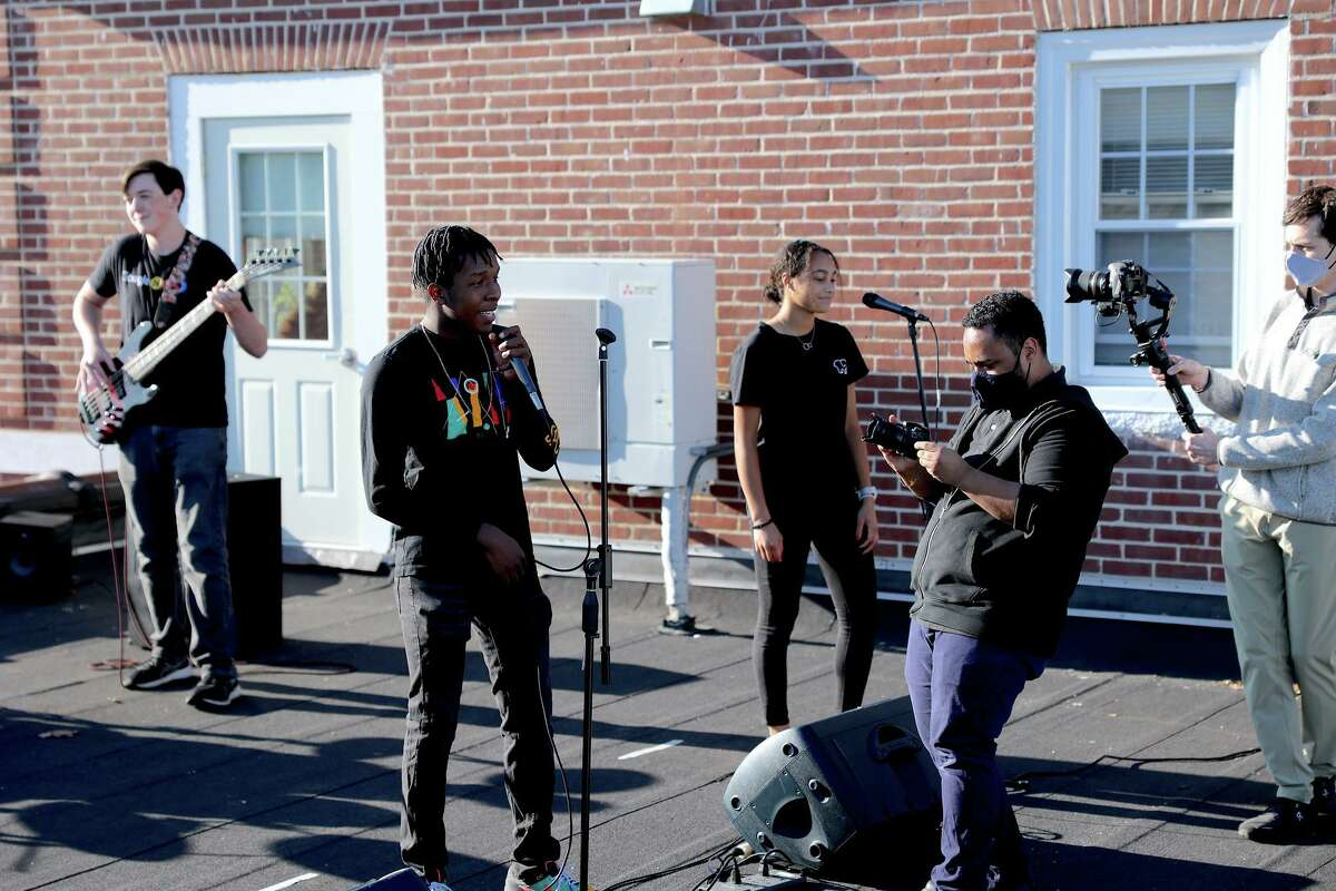 """A music video titled: """"Times Like These,"""" and featuring the St. Luke's School's in New Canaan Blues Band members, and was recently filmed on the school's rooftop, premiered at the school's 19th State of the School address on Thursday, November 19, 2020, and seems destined to go down in history as one of the coolest things a school has ever done. (From right) are: St. Luke's School Senior student Brian Douglas Class of 2021, the school's Academic Technologist, Eli Fendelman, A/V Specialist Bryan DeVissiere and the school's Blues Band."""