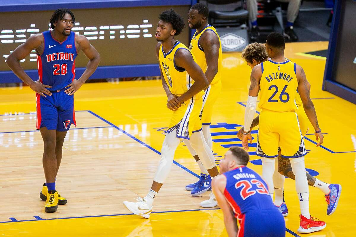 Golden State Warriors center James Wiseman (33) holds his wrist after landing on the ground after finishing a lob pass from Draymond Green in the third quarter during an NBA game against the Detroit Pistons at Chase Center on Saturday, Jan. 30, 2021, in San Francisco, Calif. The rookie has a sprained left wrist and will be re-evaluated in 7-10 days, the Warriors announced Monday afternoon.