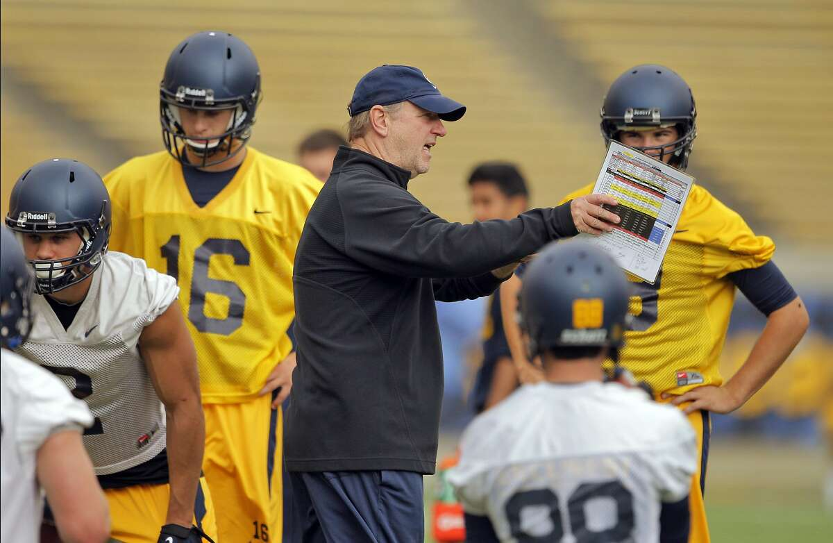 Cal's offensive coordinator Tony Franklin working with players during practice for the Cal football team at Memorial Stadium in Berkeley, Calif., on Tuesday, August 6, 2013.