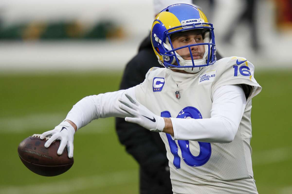 Los Angeles Rams quarterback Jared Goff warms up before an NFL divisional playoff football game against the Green Bay Packers, Saturday, Jan. 16, 2021, in Green Bay, Wis.