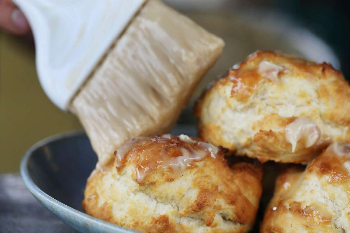 """Anthony """"Lou"""" Rizzi gives some honey butter biscuits their second basting at Lou's Takeaway in San Rafael."""