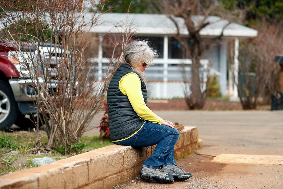 Sharron Ames at the former home of her mother, Janet, at Sherwood Forest Trailer Park in Paradise, Calif., on Sunday, January 24, 2021. Ames' mother was a victim of the 2018 Camp Fire, but died last Summer, before she could get a settlement from the PG&E bankruptcy.