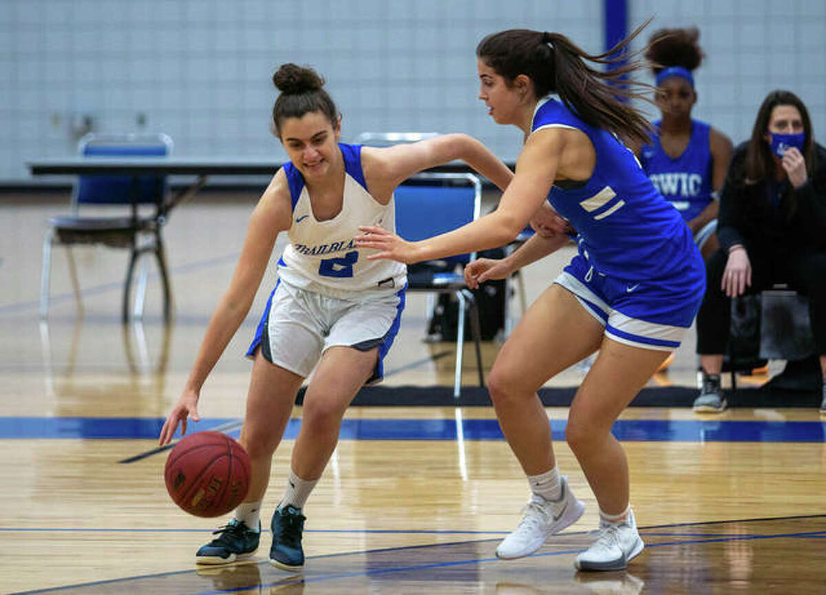 Lewis and Clark's Judith Girones (2), from Barcelona, Spain, drives around SWIC's Keiarra Cotton (23) Monday in the LCCC season opener in Godfrey.