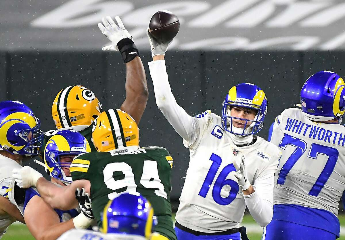 Los Angeles Rams quarterback Jared Goff (16) gets a second-quarter pass off against the Green Bay Packers during an NFC Divisional playoff game at Lambeau Field in Green Bay, Wisconsin, on Saturday, Jan. 16, 2021.