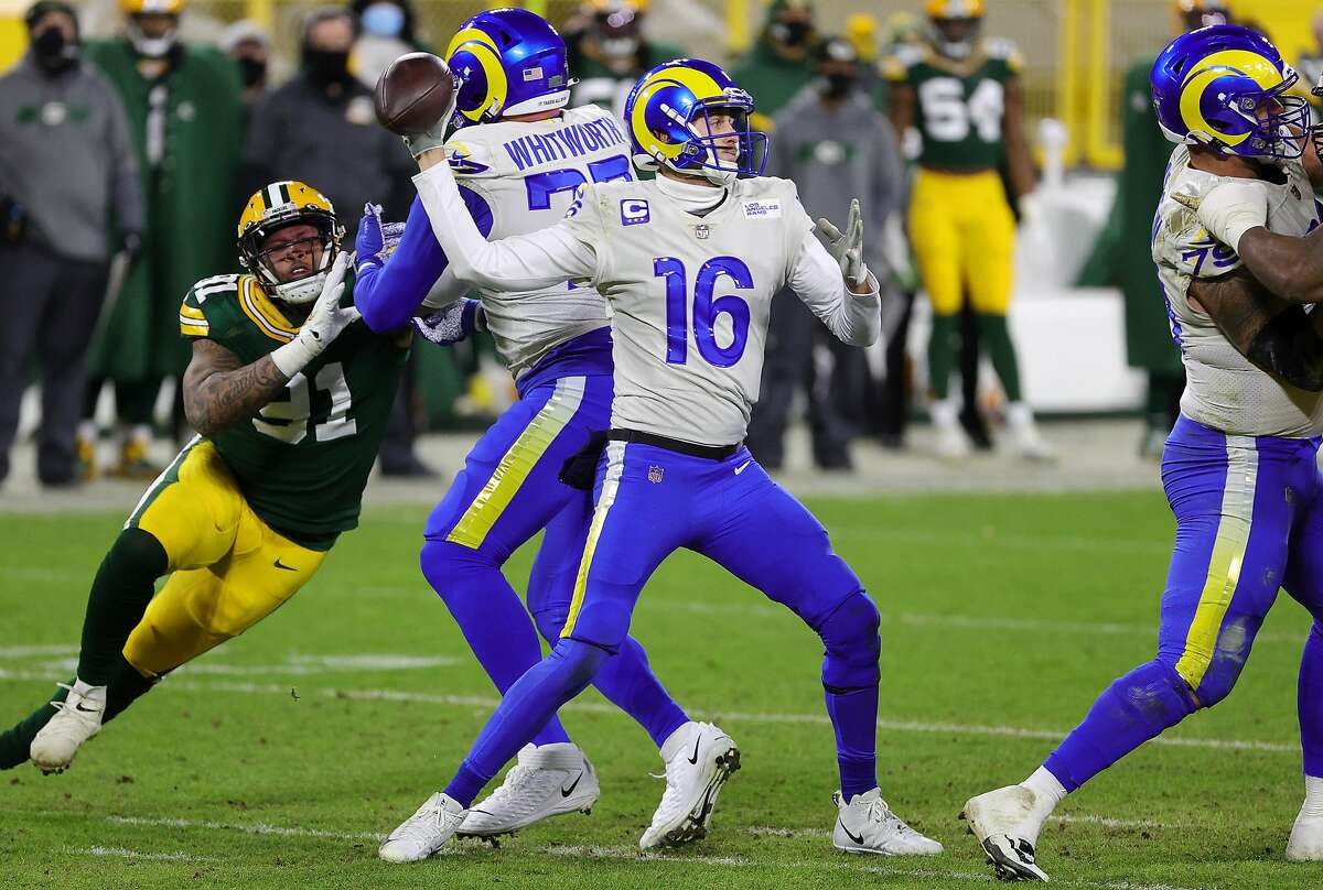 Jared Goff #16 of the Los Angeles Rams throws a pass in the second half against the Green Bay Packers during the NFC Divisional Playoff game at Lambeau Field on January 16, 2021 in Green Bay, Wisconsin.