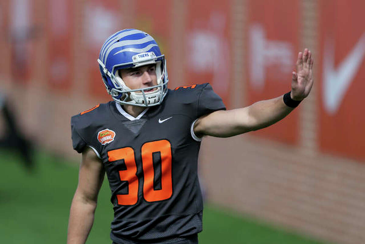 National Team kicker Riley Patterson of Memphis (30) waves to a fan in the stands during the first half of the NCAA college football Senior Bowl in Mobile, Ala, Saturday, Jan. 30, 2021. Patterson, an Edwardsville graduate, was named the top specialist the National squad in a team vote at the player-of-the-week awards ceremony for the Reese's Senior Bowl.