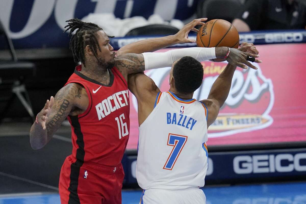 Houston Rockets guard Ben McLemore (16) fouls Oklahoma City Thunder forward Darius Bazley (7) in the second half of an NBA basketball game, Monday, Feb. 1, 2021, in Oklahoma City. (AP Photo/Sue Ogrocki)