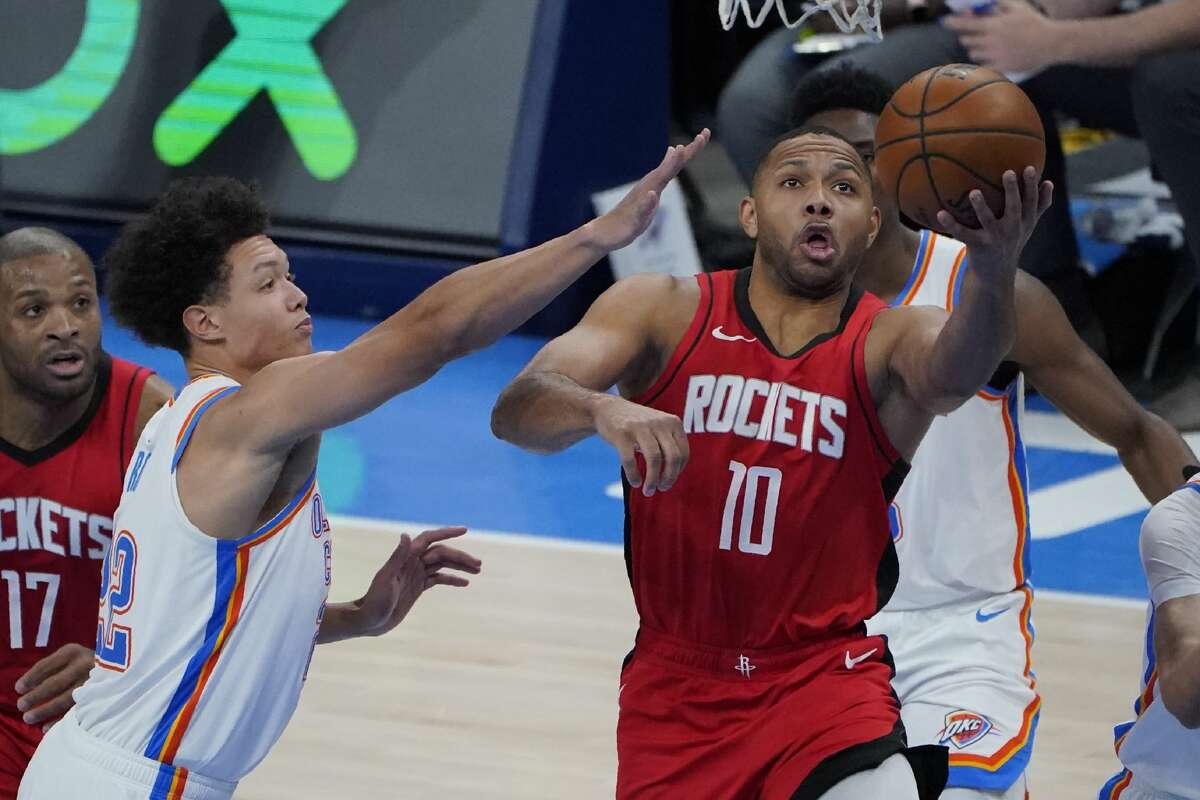 Houston Rockets guard Eric Gordon (10) goes to the basket in front of Oklahoma City Thunder forward Isaiah Roby, left, in the second half of an NBA basketball game, Monday, Feb. 1, 2021, in Oklahoma City. (AP Photo/Sue Ogrocki)