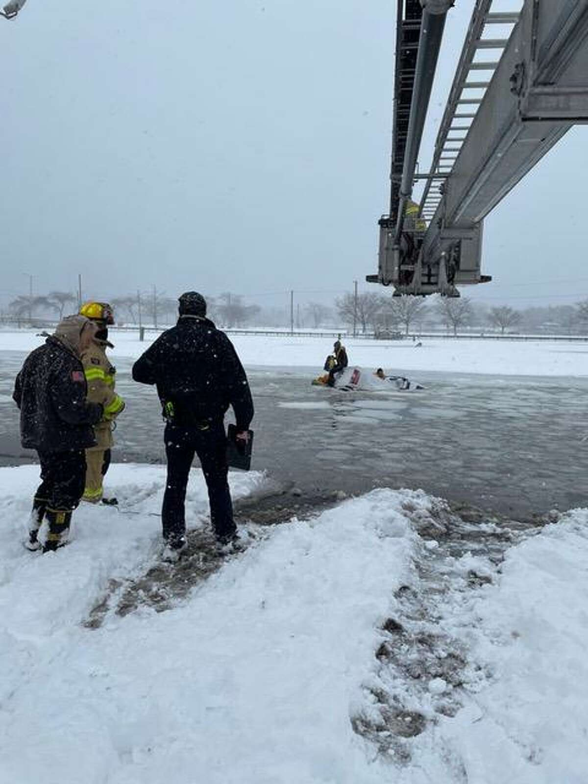STAMFORD, Conn. - Firefighters pulled two people out of Long Island Sound Monday, Feb. 1, 2021, after their pickup truck went into the water at Cummings Park.