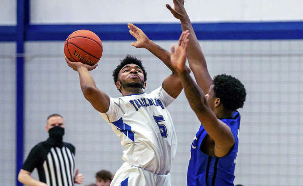 LCCC guard Kenneth Dixon (5) forces up a shot Monday night in the Trailblazers' season opener at the River Bend Arena in Godfrey. Dixon is a freshman from Rome, Ga.