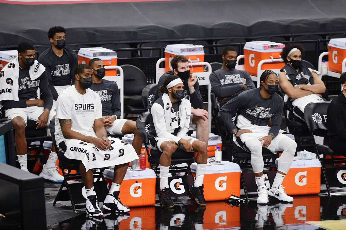 LaMarcus Aldridge, from left, Patty Mills, DeMar DeRozan and the Spurs won't be back in action until Feb. 24 at the earliest.