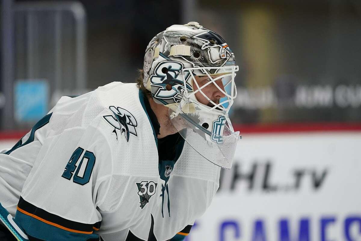 San Jose Sharks goaltender Devan Dubnyk (40) in the first period of an NHL hockey game Thursday, Jan. 28, 2021, in Denver. (AP Photo/David Zalubowski)