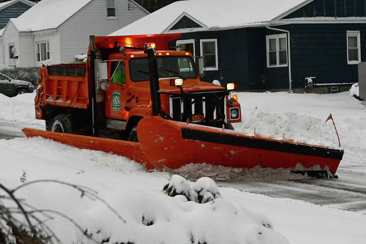A snowplow clears a residential road during a nor'easter snow storm on Tuesday, Feb. 2, 2021 in Guilderland, N.Y. (Lori Van Buren/Times Union)