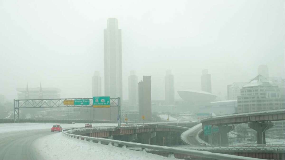 Snow falls in Albany as a nor'easterover the Northeast continues to drop snow on Tuesday.