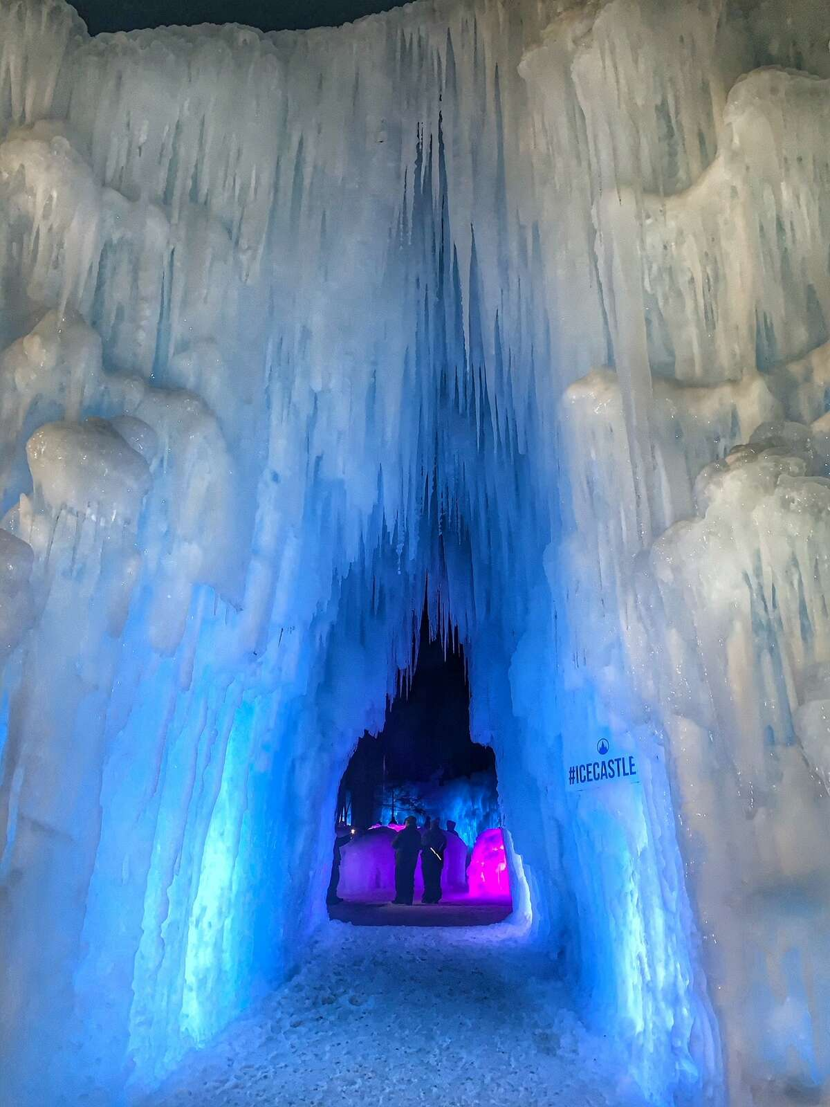 A glowing entrance to the New Hampshire Ice Castle.