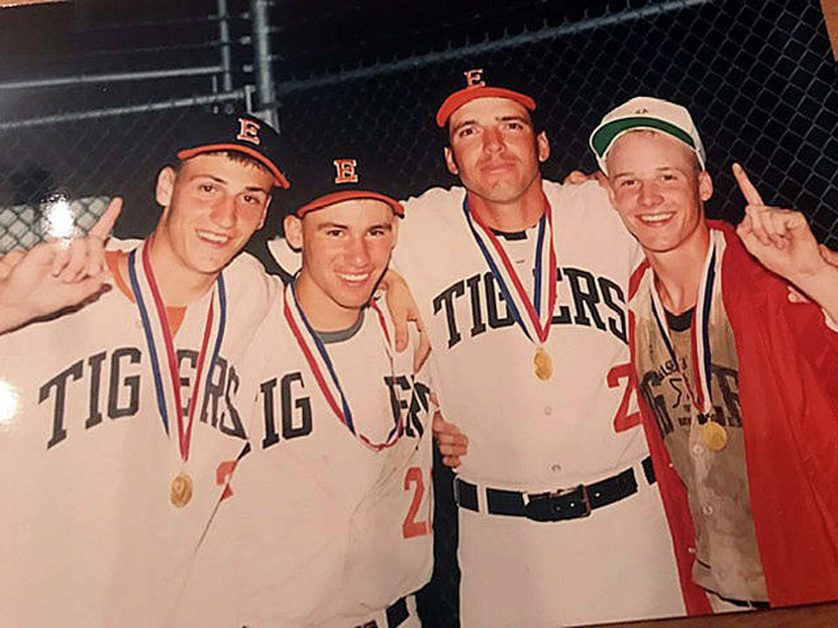 Left to right, Joe Blasingim, Tom Price, pitching coach Mike Waldo and Mark Little celebrate after Edwardsville won the Class AA state championship in 1990.